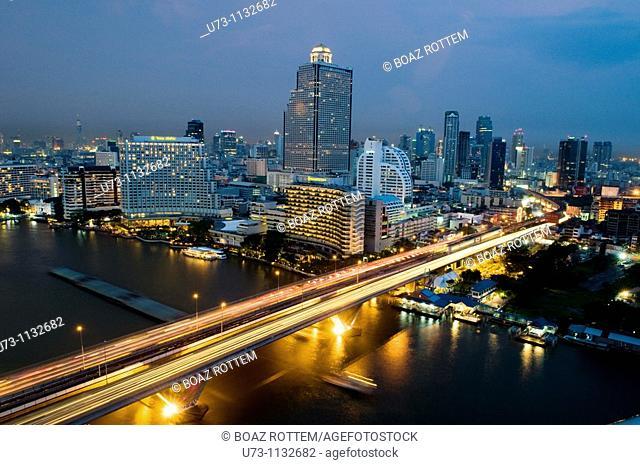 Night shot of downtown Bangkok and the Chao Phraya river