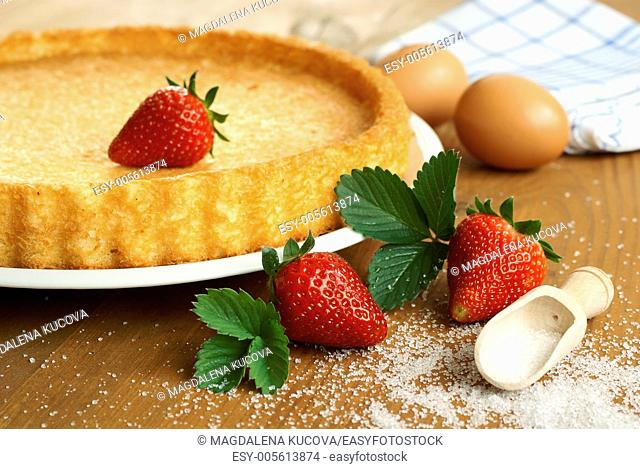 Baked cake, eggs and strawberries - baked cake before decorating