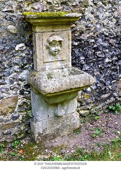 Ornate stone fountain, with human face, Normandy, France