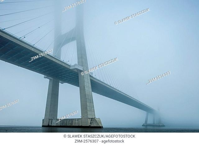 Foggy afternoon at Vasco da Gama Bridge in Lisbon, Portugal