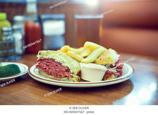 Meat sandwich on plate, on diner table