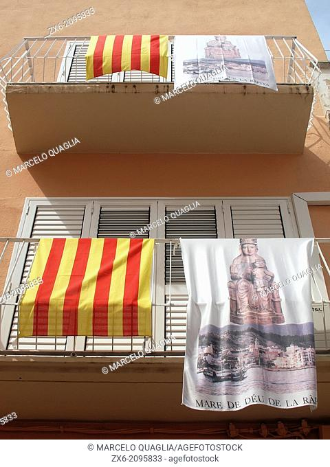 Catalan flags and Patron Saint posters hanging from balconies. Sant Carles de la Rapita Village. Montsia Region, Tarragona Province, Catalonia, Spain