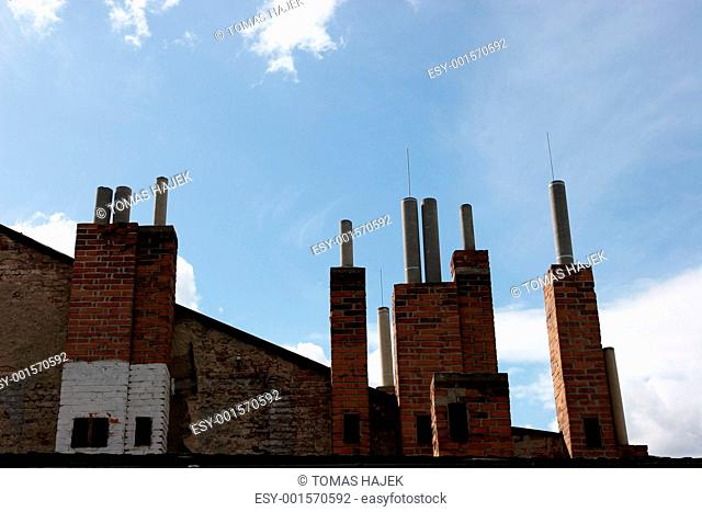 Many of brick chimneys on the top of the house