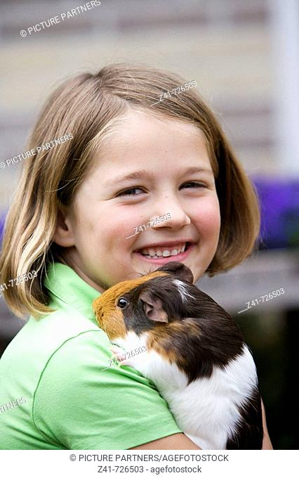 Girl with a guinea-pig