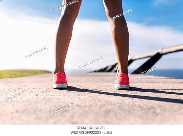 Legs of female runner, rear view