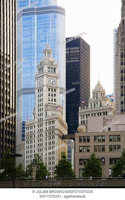 The Wrigley clock tower dominated by newer buildings in Chicago