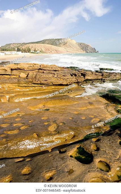 Ocean Rock with a view along Luz Beach, Portugal