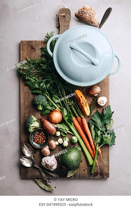 Cooking pot and various organic ingredients, top view, cooking concept