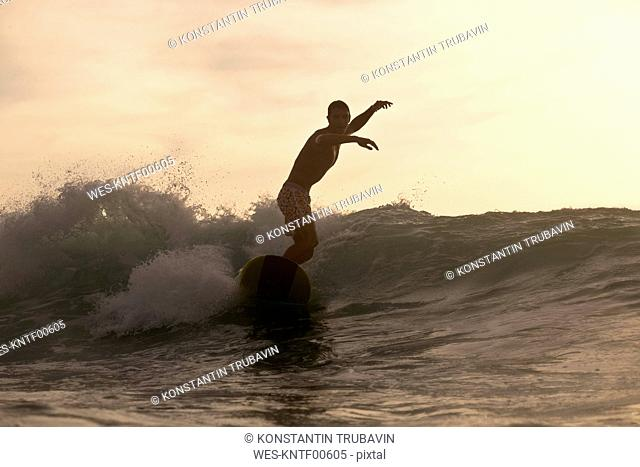 Indonesia, Bali, surfer at sunset
