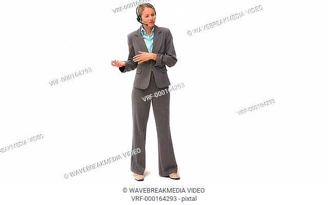 Business woman standing up with an headset