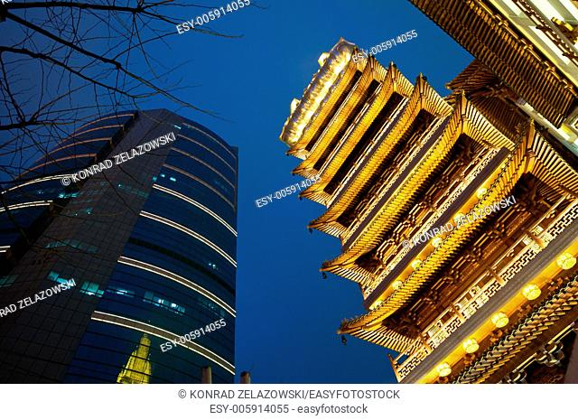 illuminated Buddhist Jing'an Temple pagoda on the West Nanjing Road in Jing'an District, Shanghai, China