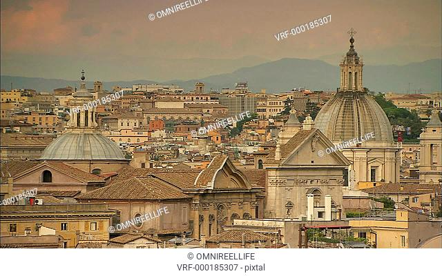 Rome city skyline with church domes and hills in distance