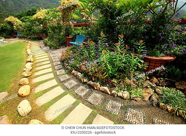 Gardening in Kek Lok Si Temple, Penang, Malaysia