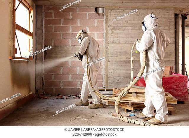 Spraying polyurethane foam, thermal and acoustic insulation, housing under construction. Donostia, Gipuzkoa, Basque Country, Spain
