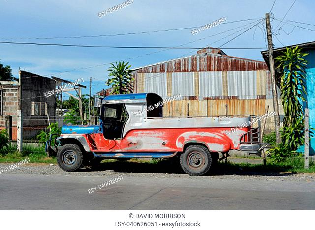 plain and undecorated jeepney in the Philippines
