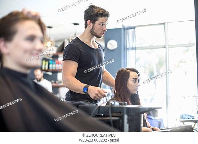 Woman in hair salon discussing with hairdresser