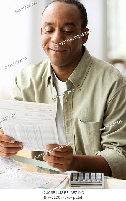 African man paying bills