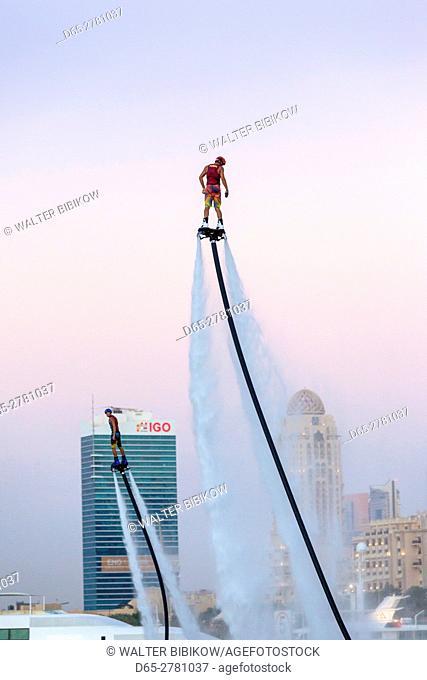 UAE, Dubai, Dubai Marina, Jumeirah Beach, water jet pack stunt flyers, dusk