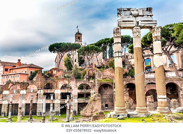Temple of Vespasian and Titus Corinthian Columns Roman Forum Rome Italy. Temple created in 79 AD by Emperor Titus, finished by Emperor Vespacian Forum rebuilt...