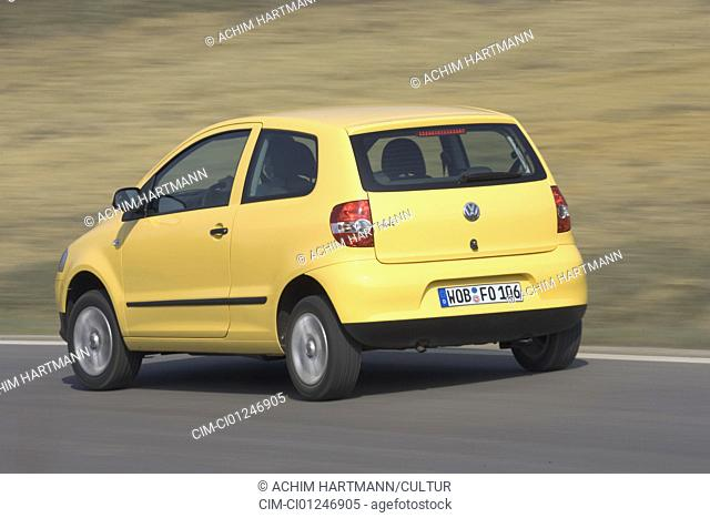 Car, VW Volkswagen Fox, model year 2005-, yellow, Miniapprox.s, Limousine, driving, diagonal from the back, rear view, side view, country road
