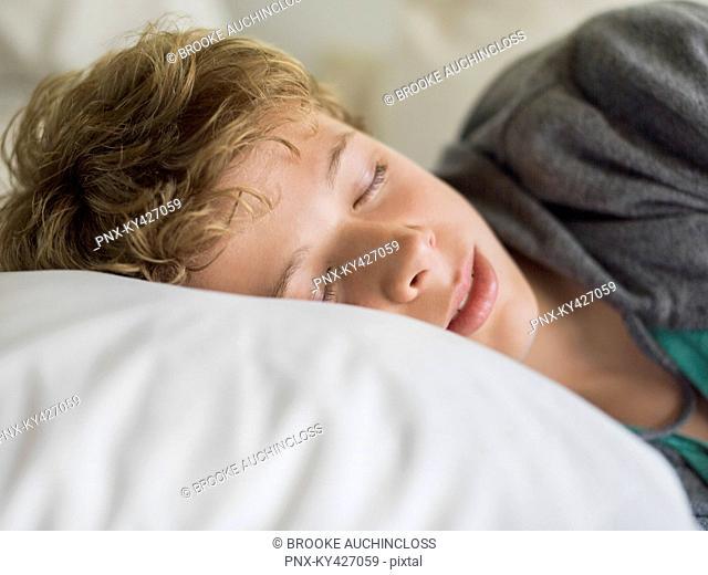 Teenage boy sleeping on the bed