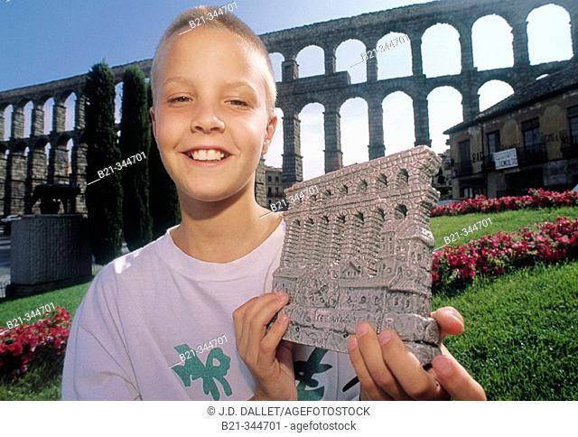 Roman aqueduct and souvenir. Segovia. Spain