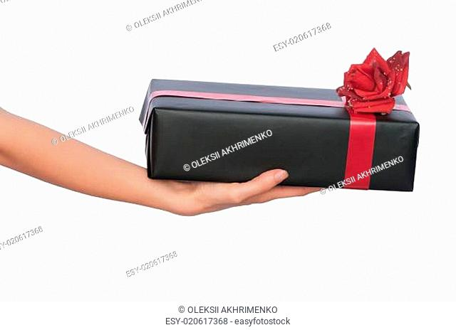 black box with red ribbon as a gift