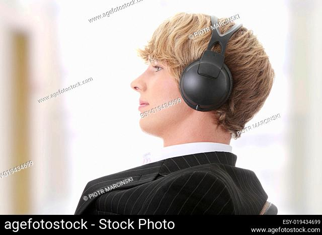 Young businessman relax with music