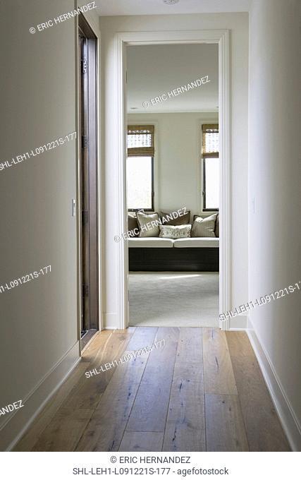 Hardwood floor in hallway leading to sitting area