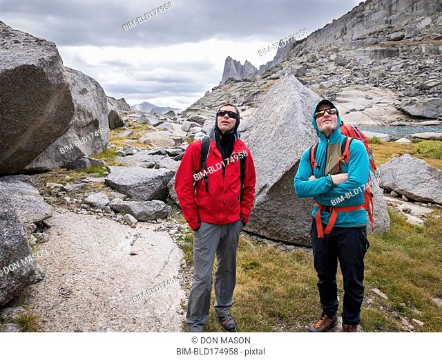 Caucasian climbers admiring mountainside
