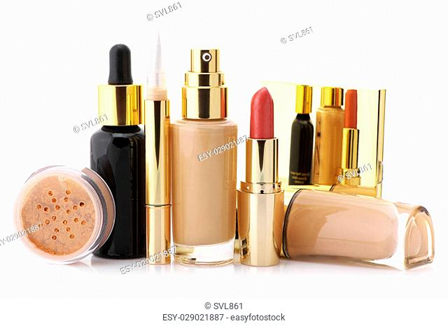 Cosmetic set: liquid foundation, concealer, mineral powder, lipstick and face serum isolated on white background