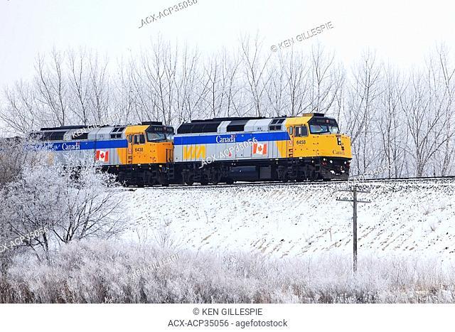 Via Rail train locomotives in winter. Winnipeg, Manitoba, Canada