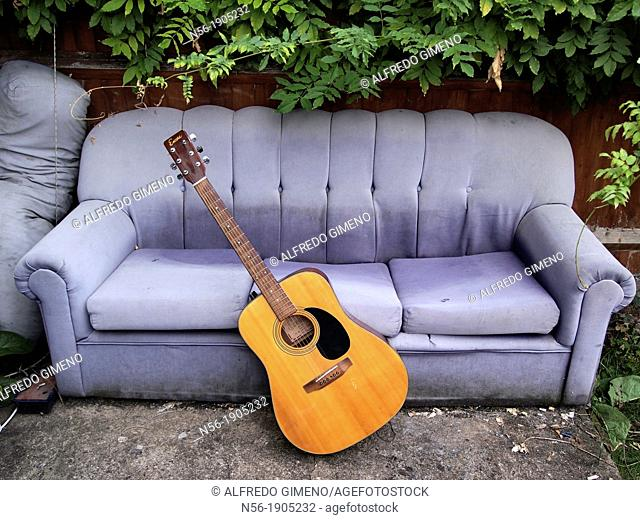 House Garden with sofa and Guitar, London, Ealing Broadway