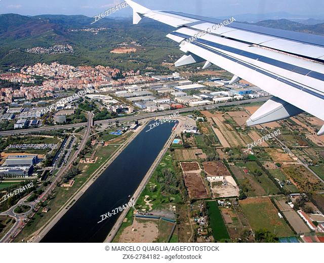 Aerial view of Olympic Aquatic Sports Channel at Castelldefels City and industrial area. Barcelona Metropolitan Area, Catalonia, Spain