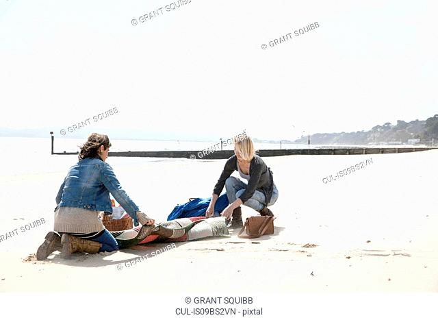 Sisters leaving after picnic on beach