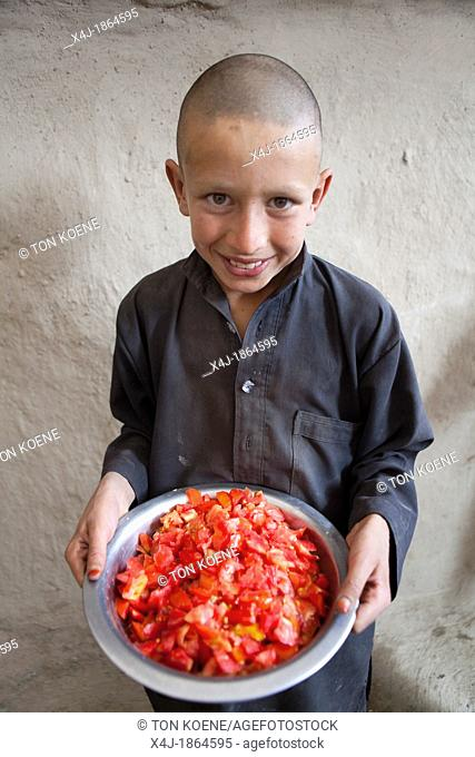 Afghan boy with tomatoes