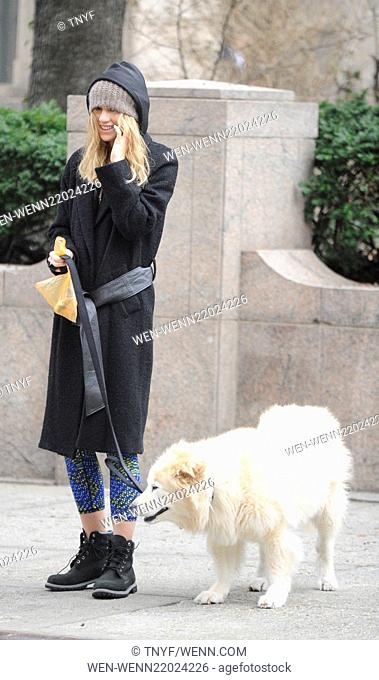 Suki Waterhouse out walking her dog on a cold day in Manhattan. She also makes a rude finger gesture at photographers Featuring: Suki Waterhouse