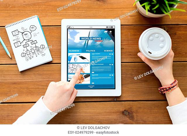 business, education, technology and people concept - close up of woman with internet news application on tablet pc computer screen