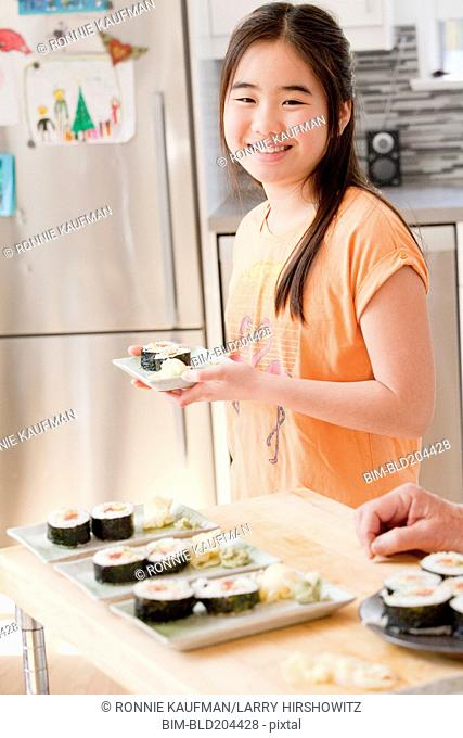 Japanese girl cooking in kitchen