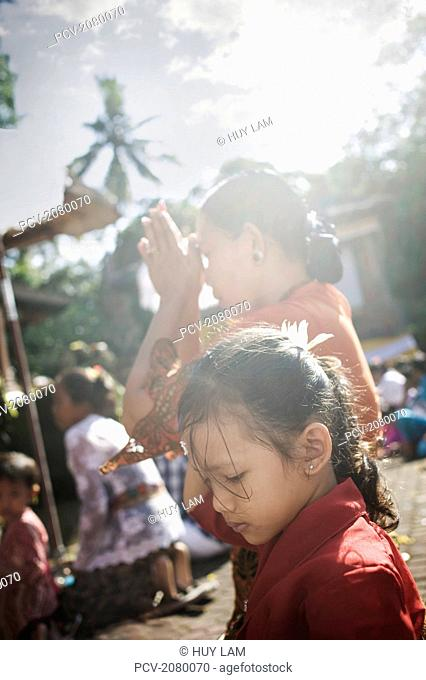 Women praying during Kuningan Festival; Bali, Indonesia