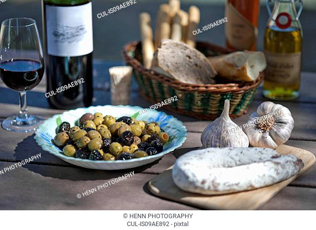 Wine, olives, sausage and traditionally french foods for picnic