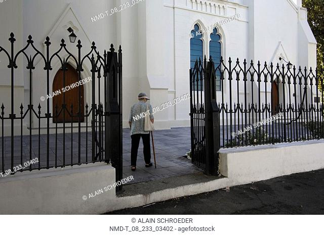 Rear view of a man walking with holding a cane, Dutch Reformed Church, Stellenbosch, Western Cape Province, South Africa