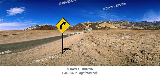 Highway with sign, Death Valley National Park, California, USA