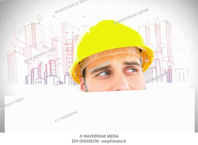 Composite image of repairman looking away while in front of billboard