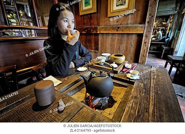 "Asian woman in an old teahouse at """"Jiufen Tea House"""". Taiwan (China), New Taipei City, Ruifang, Jiufen (Chiufen). Model Released"
