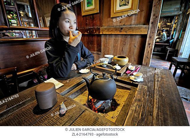 "Asian woman in an old teahouse at """"Jiufen Tea House"""". Taiwan (China), New Taipei City, Ruifang, Jiufen (Chiufen). Model Released"