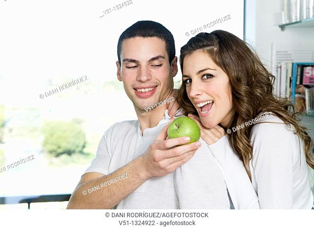 Young couple having breaksfast in the kitchen in the morning