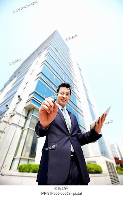 Asian Businessman Using Digital Tablet
