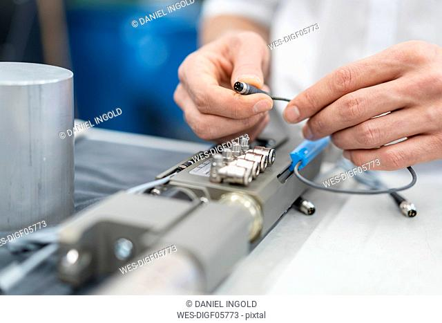 Close-up of man working on workpiece in a factory