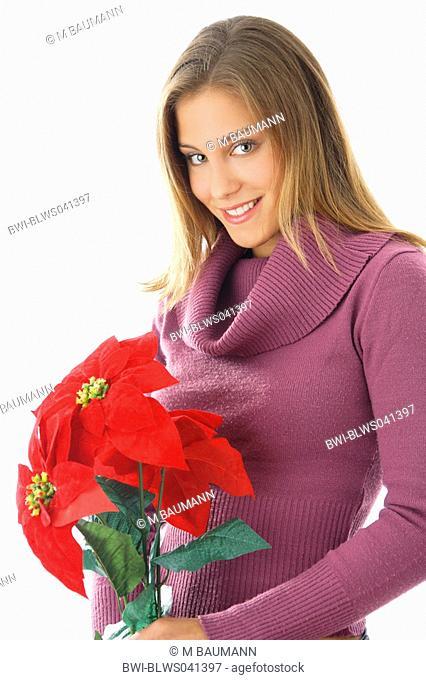 poinsettia Euphorbia pulcherrima, Young woman with poinsettia